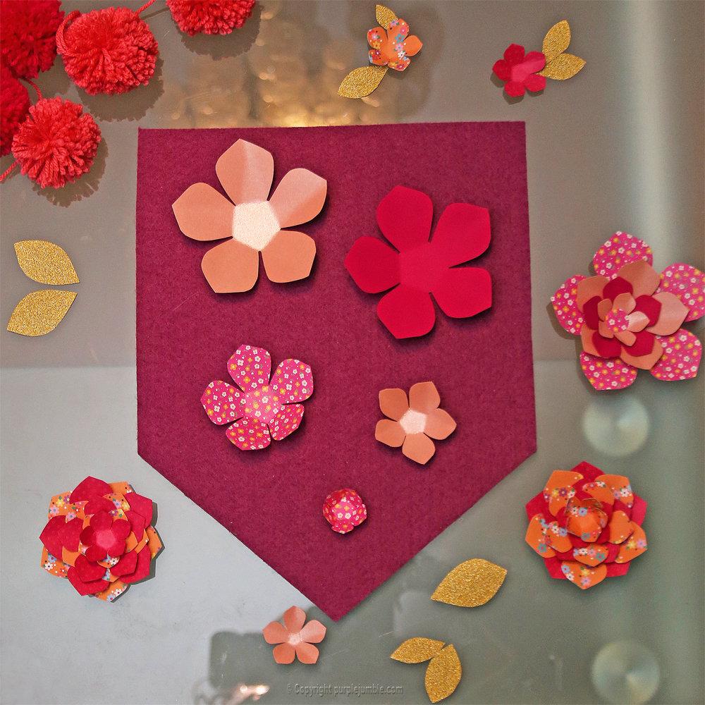 Banniere feutrine fleurs papier pompons 8
